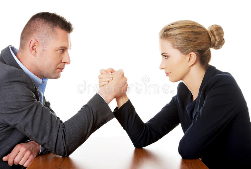 Businesspeople fighting on hands. Young businesspeople fighting on hands royalty free stock photo