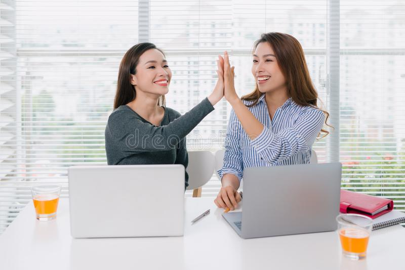 Businesspeople giving high five in the office royalty free stock image