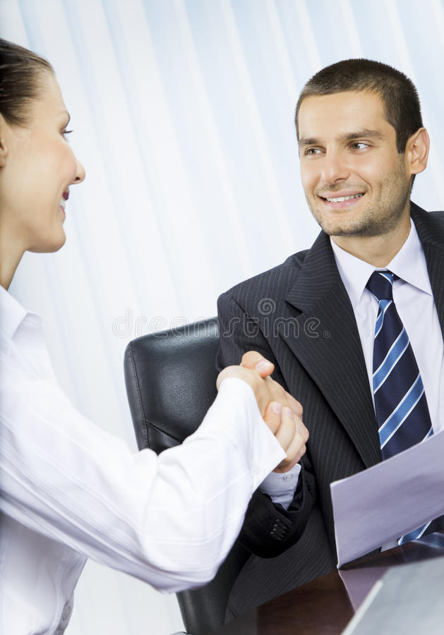 Businesspeople handshaking. Two businesspeople, or businessman and client handshaking stock photos