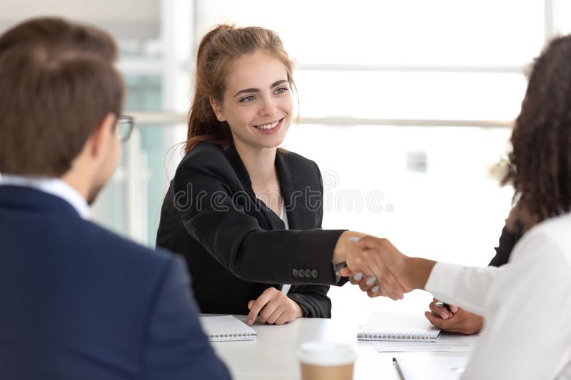 Businesspeople handshaking at the beginning of multinational negotiations royalty free stock images
