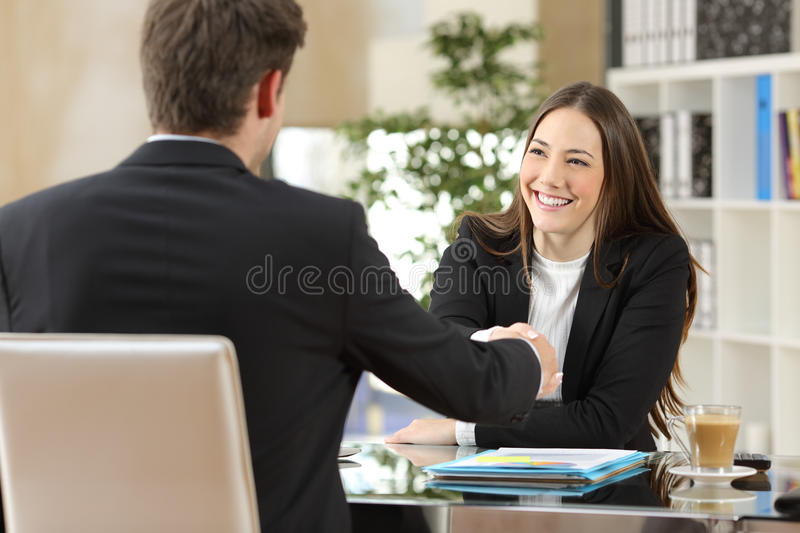 Businesspeople handshaking after negotiation royalty free stock image