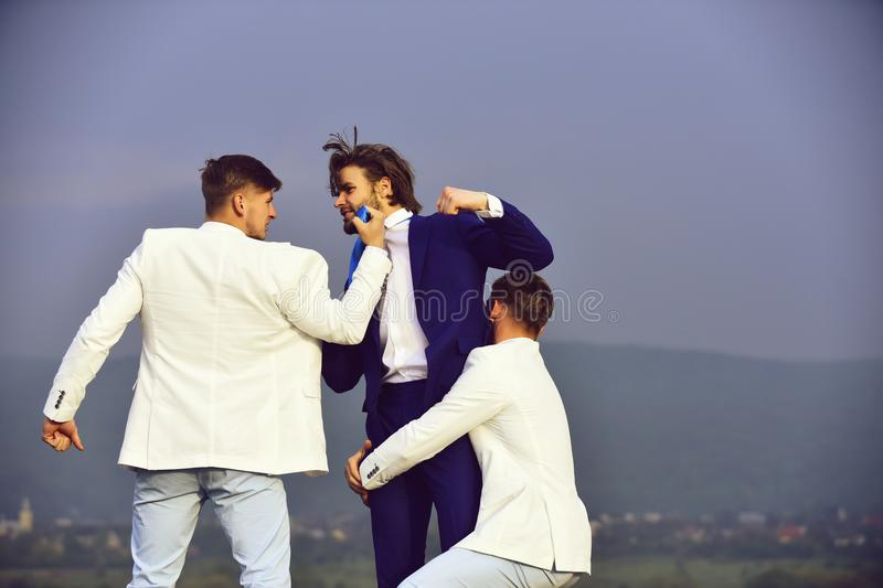 Businesspeople have competition, businessman, team in white outfit fighting outdoor royalty free stock photography