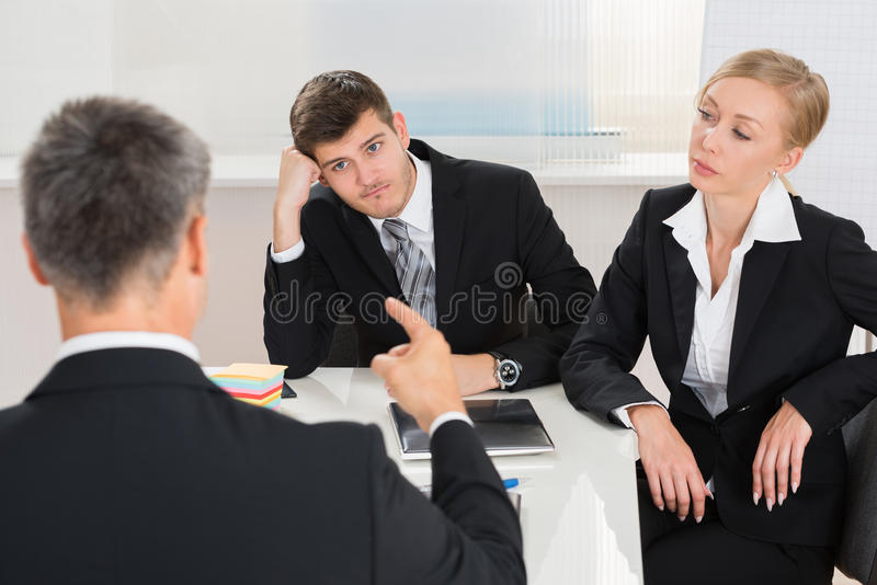 Businesspeople Having Argument At Workplace royalty free stock photos