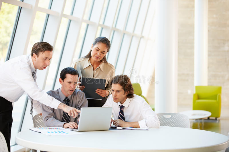 Businesspeople Having Meeting Around Table In Modern Office stock images