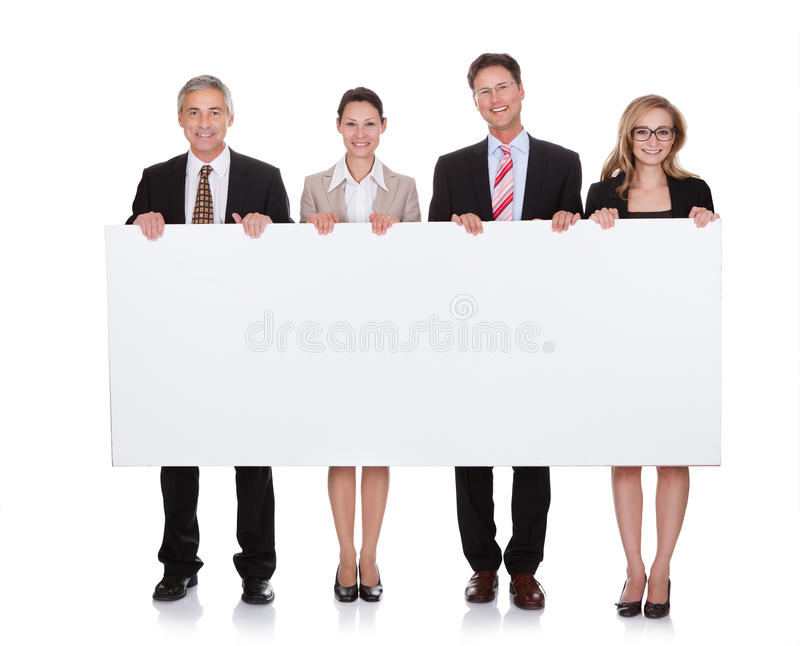 Businesspeople holding a blank banner royalty free stock photo