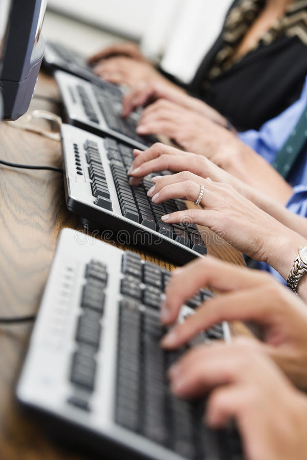 Businesspeople On Keyboards Stock Images