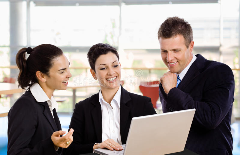 Businesspeople with laptop stock images