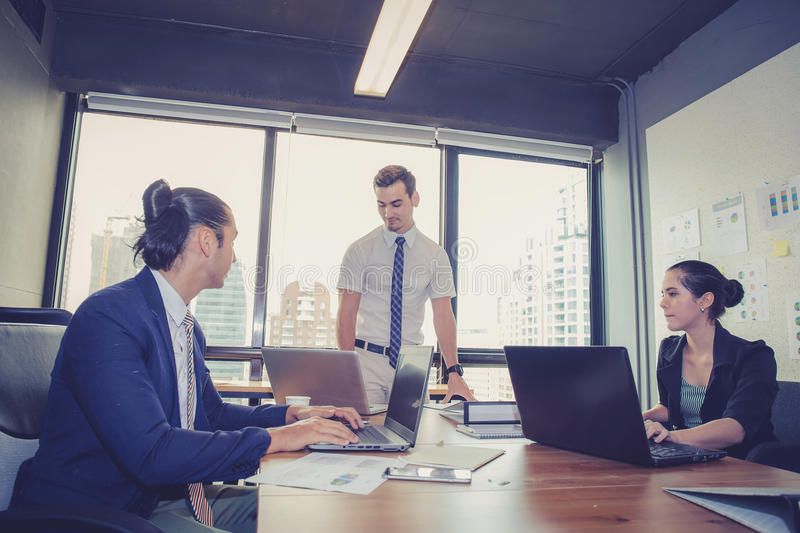 Businesspeople with leader discussing together. Businesspeople with leader discussing together in conference room during meeting at office royalty free stock images
