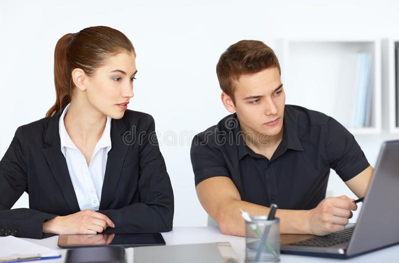 Businesspeople looking at computer screen stock photos