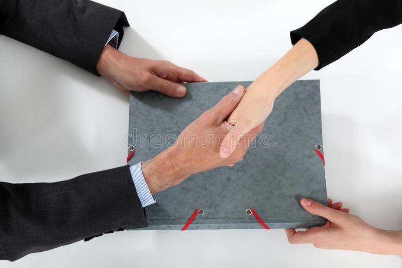 Businesspeople making a deal. Businesspeople shaking ahnds to seal the deal stock photography