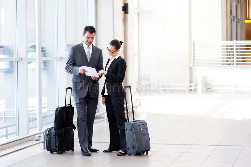 Businesspeople meeting at airport stock photos