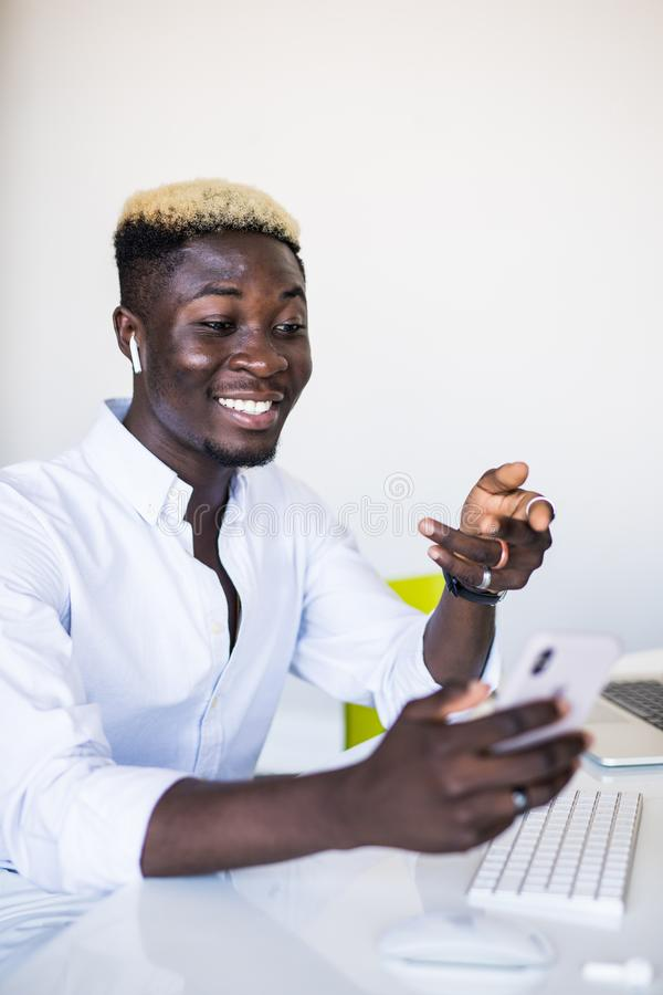 Businesspeople, modern technology and communication concept. Young African American man employee working on generic laptop stock photos