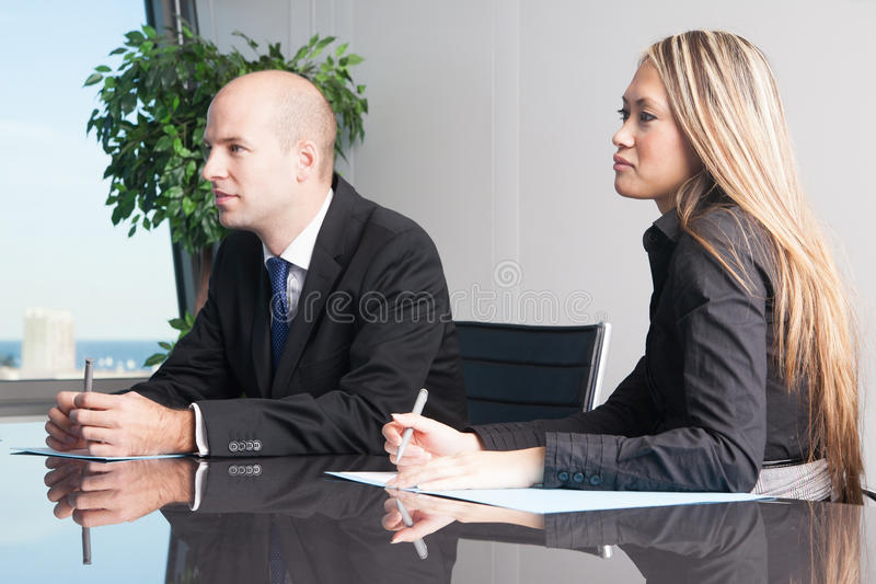 Businesspeople during negotiations. Business team in negotiations waiting for decision stock photos