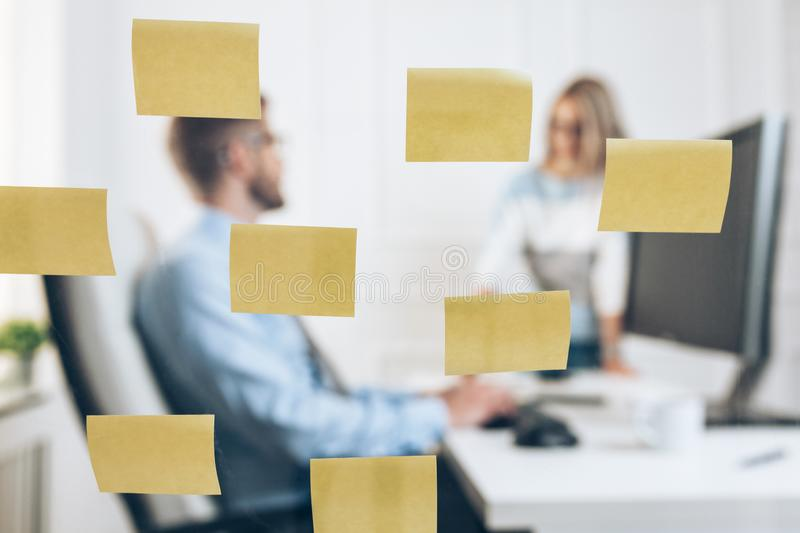 Businesspeople at the office behind a glass wall stock image
