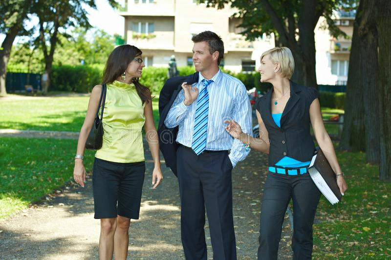 Businesspeople in park stock photography
