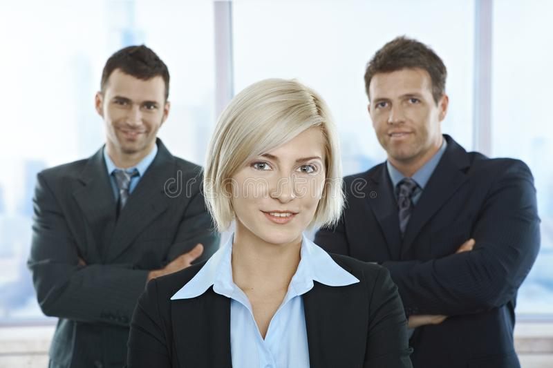 Businesspeople portait. Portrait of successful businesspeople standing with arms folded in office stock image