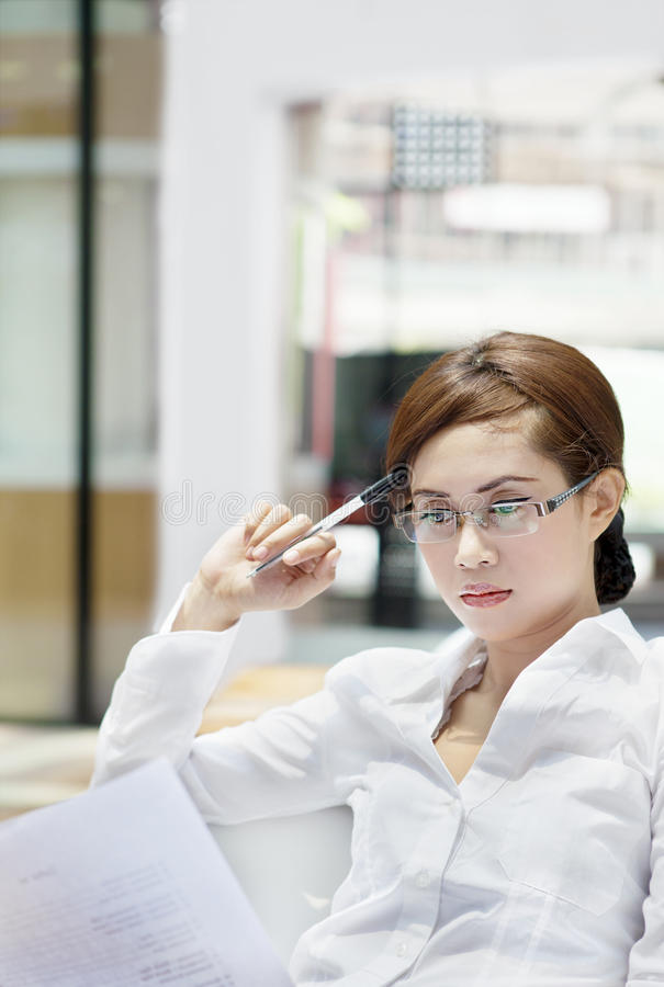 Download Businesspeople Reads A Document Stock Photo - Image of beauty, adult: 26834644