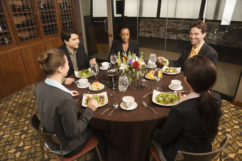 Businesspeople in restaurant. royalty free stock photo