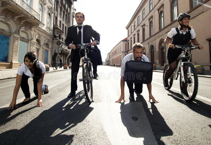 Download Businesspeople Riding On Bikes And Running Stock Photo - Image: 26913860