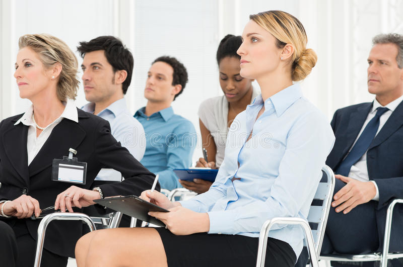 Businesspeople In Seminar. Multiracial Businesspeople Attending A Seminar Together
