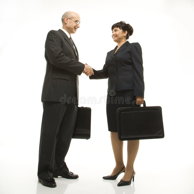 Businesspeople shaking hands. stock images