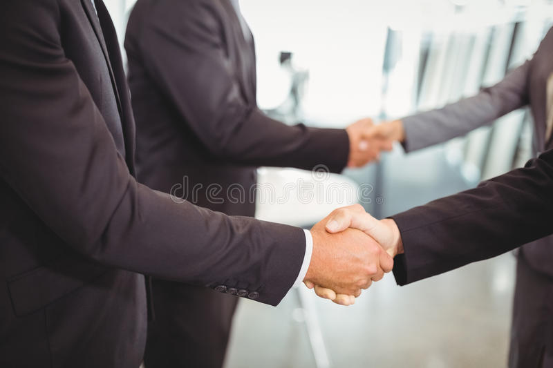 Businesspeople shaking hands with each other royalty free stock image
