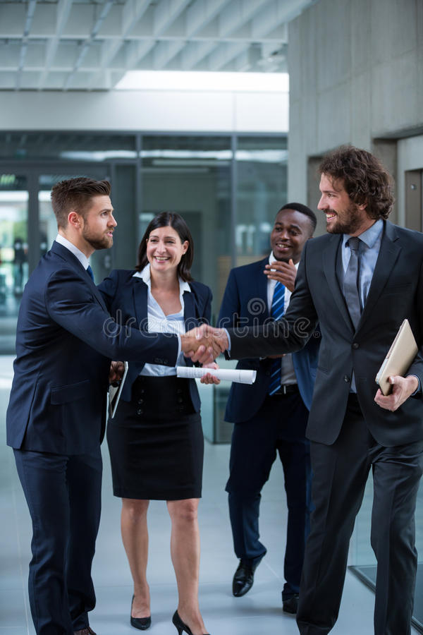 Businesspeople shaking hands with each other royalty free stock images