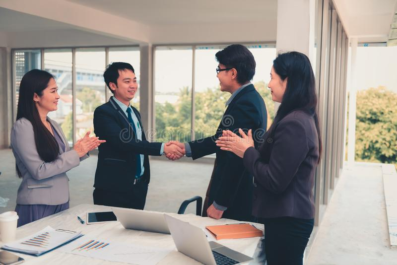 Businesspeople shaking hands together after dealing project comp royalty free stock photo