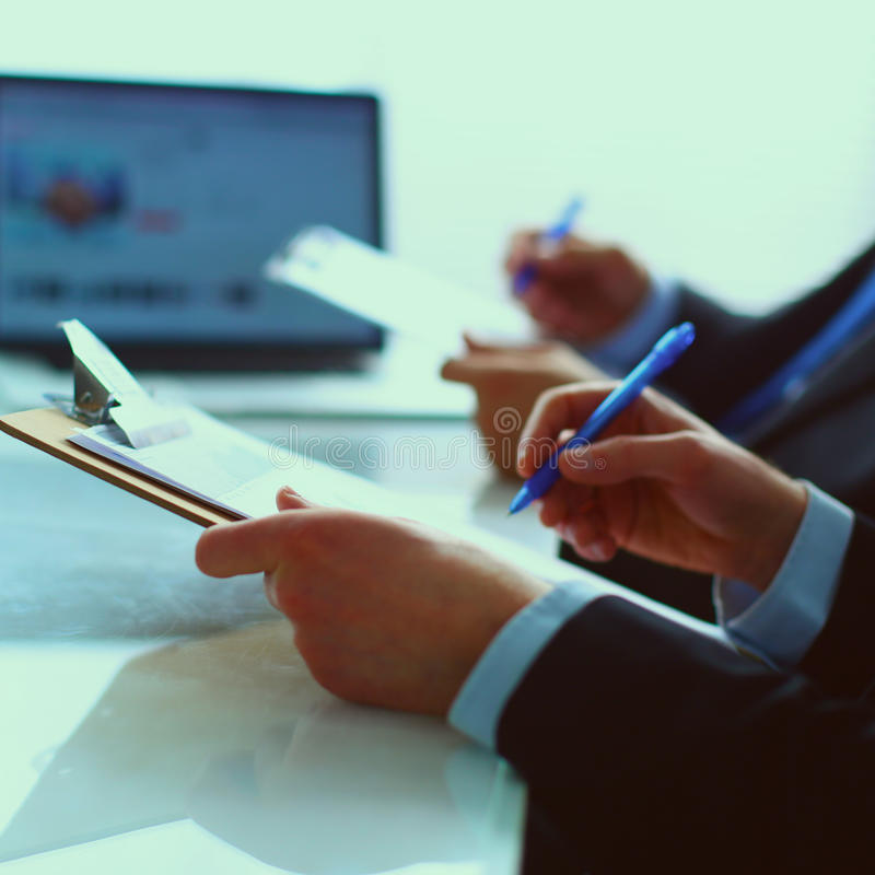 Businesspeople sitting on the desk on office.  stock photo