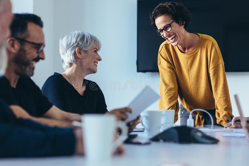 Businesspeople smiling during a meeting royalty free stock photography