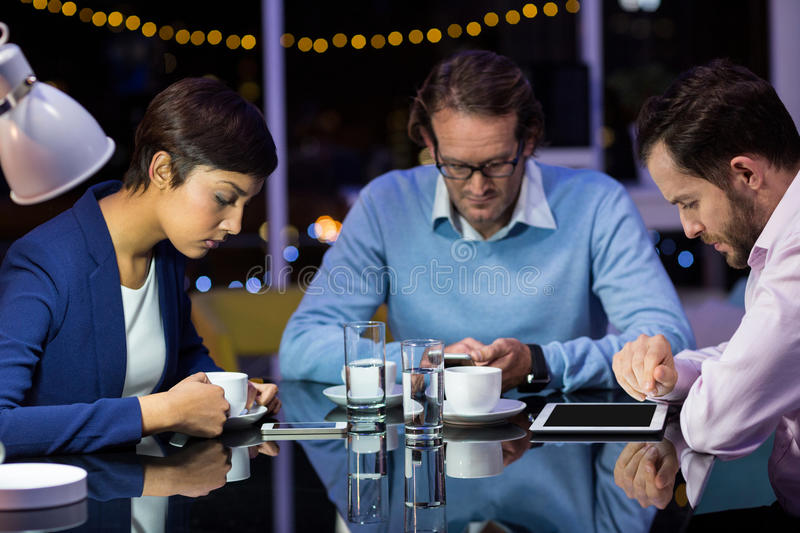 Businesspeople taking tea break. In office at night royalty free stock photography