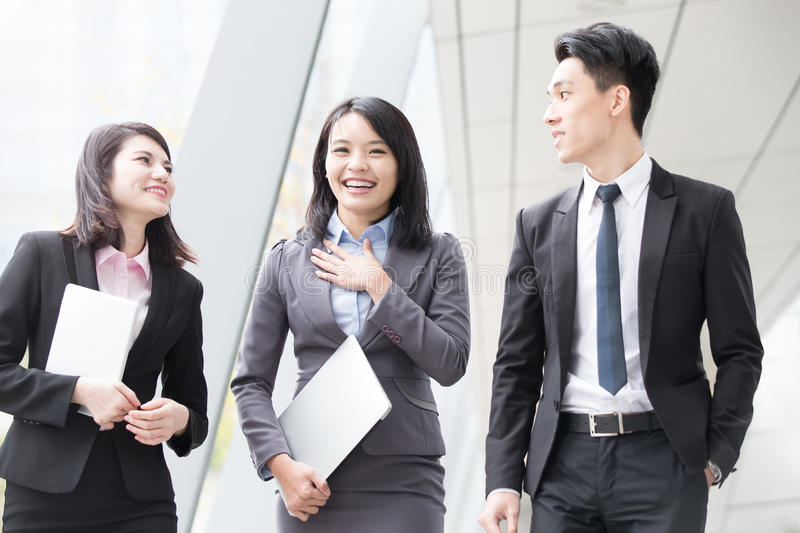 Businesspeople talk in office stock image