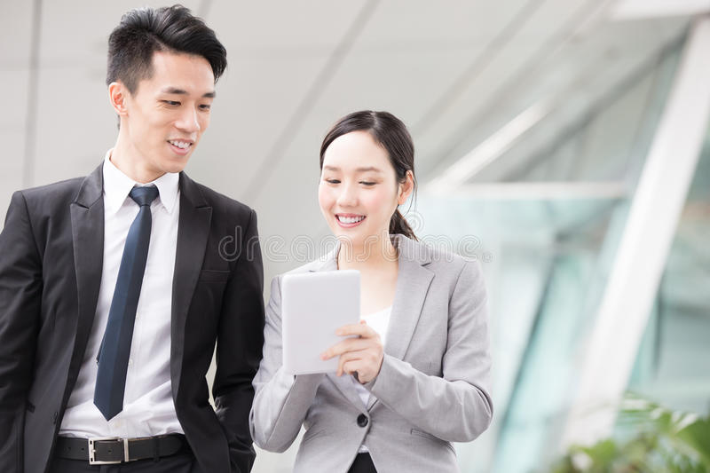 Businesspeople talk in office stock photos