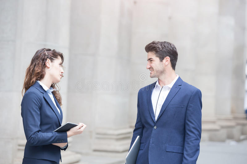 Businesspeople talk and walk royalty free stock image