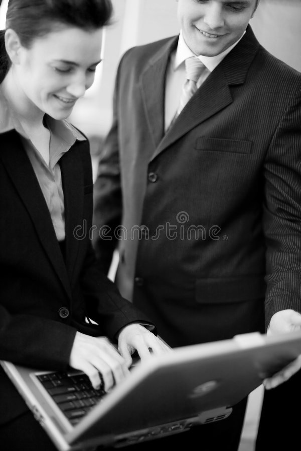 Businesspeople technology. Businessman and businesswoman working together on laptop stock photo