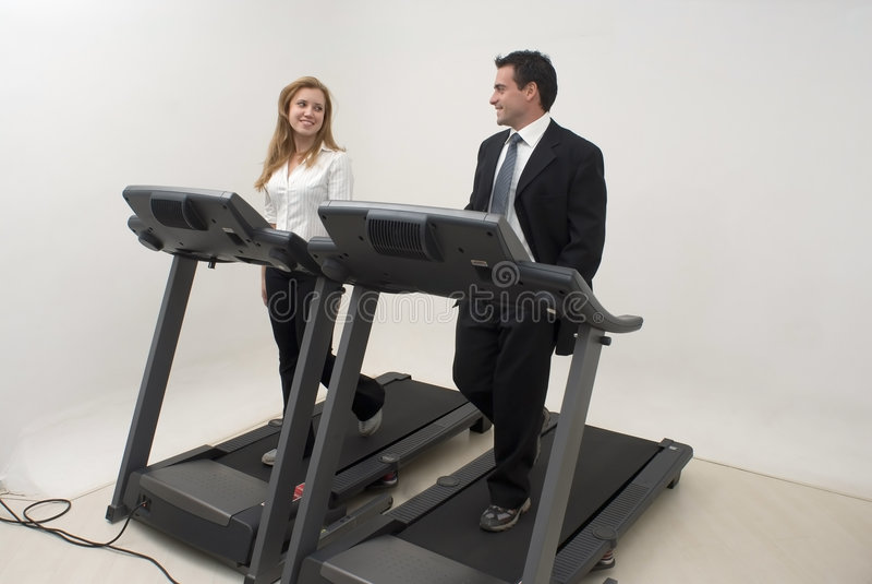 Businesspeople on Treadmill - Horizontal royalty free stock photo