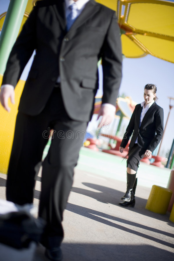 Businesspeople walking. Businessman and businesswoman walking in same direction stock photos