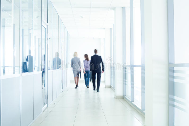 Businesspeople walking royalty free stock photos