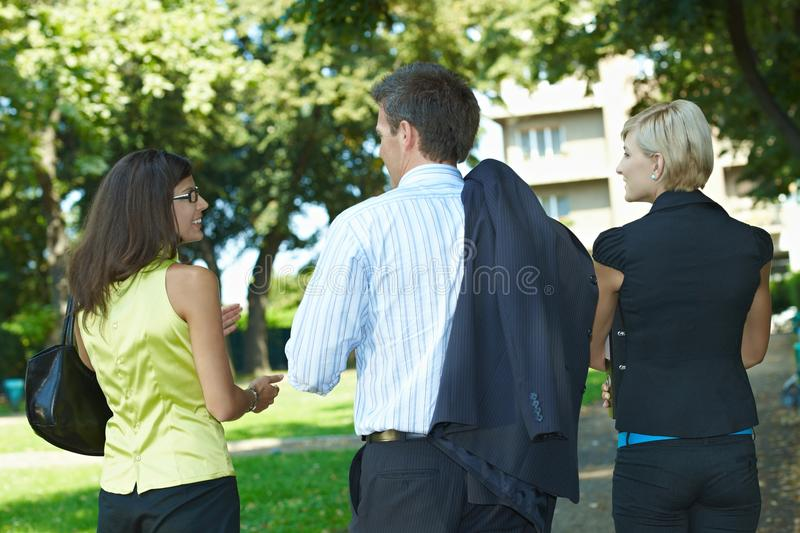 Download Businesspeople Walking In Park Stock Photo - Image: 11072692