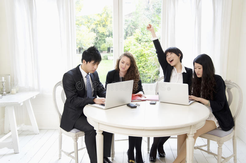 Businesspeople working on laptop stock images