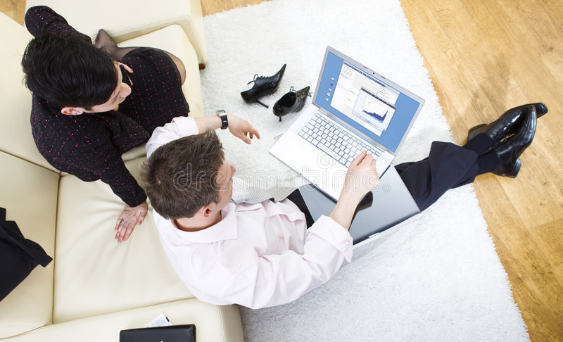 Businesspeople working on laptop royalty free stock photography