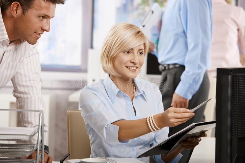 Download Businesspeople Working In Office Stock Photo - Image: 12915394