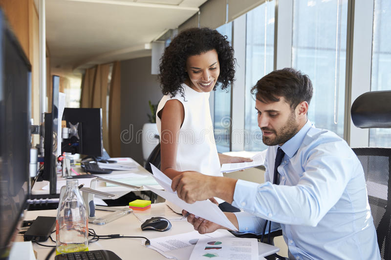 Businesspeople Working At Office Desk On Computer Together royalty free stock image