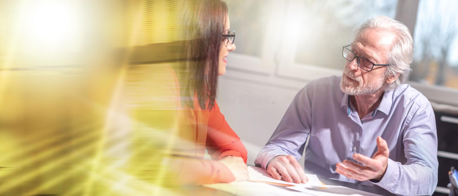 Businesspeople working in office, light effect; multiple exposure royalty free stock photo