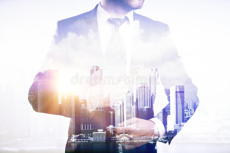 Businessperson on city background, multiexposure. Businessperson on city background. Double exposure royalty free stock photo