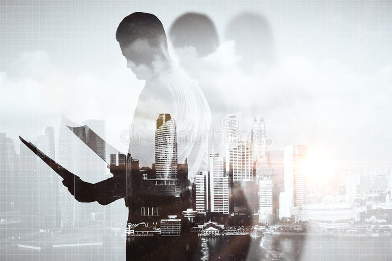 Businessperson with document. On abstract city background. Double exposure stock photography