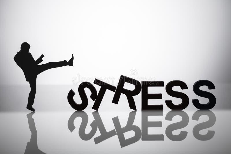 Businessperson Kicking Stress Word royaltyfri bild