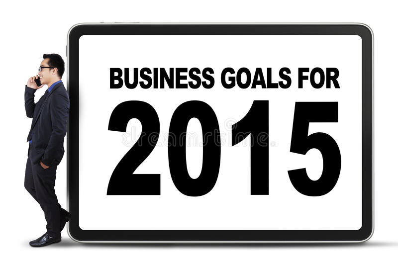 Businessperson leunt op een bedrijfsdoelstellingen raad stock afbeeldingen