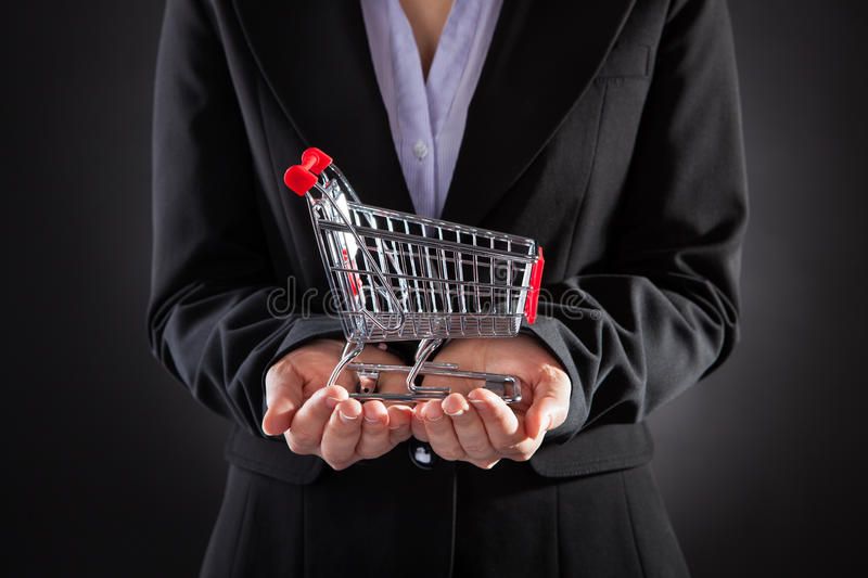 Businessperson With Shopping Cart royaltyfria foton