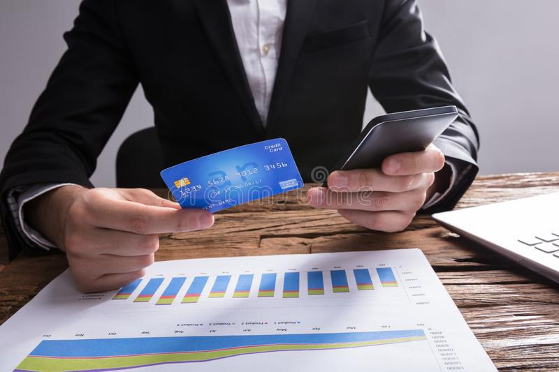 Businessperson Shopping Online With Mobile Phone And Credit Card royalty free stock image